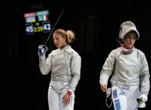 Olga Kharlan (L) of Ukraine celebrates the victory after competing against Rossella Gregorio of Italy in their women's team sabre third place match at the World Fencing Championships in Kazan July 21, 2014. REUTERS/Grigory Dukor