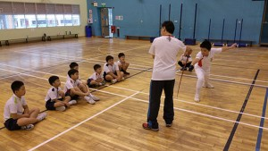 Coach teaching Fencers from Poi Ching School