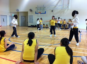 Students in School applying what they learnt in a fencing bout.
